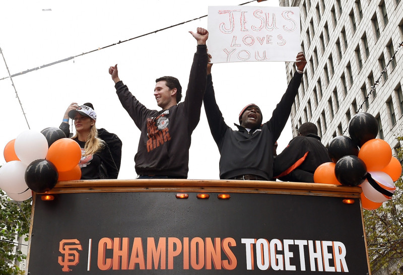 Buster Posey (L) and Santiago Casilla (R) of the San Francisco Giants, waved to the crowd along the parade route during the San Francisco Giants World Series victory parade. (Thearon W. Henderson/Getty Images)
