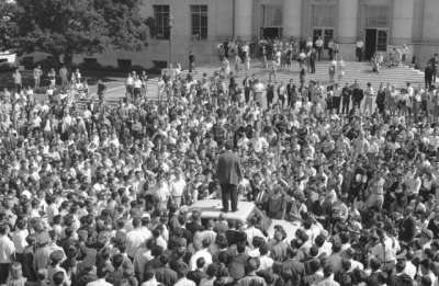 Mario Savio stands on top of police car in front of UC Berkeley's Sproul Hall on Oct 1. 1964. The protest is considered the birth of the Free Speech Movement. (Courtesy of UC Berkeley, The Bancroft Library).