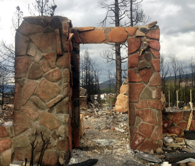 This stone entryway is all the Boles Fire left standing of this home in Weed. (Daniel Potter/KQED)