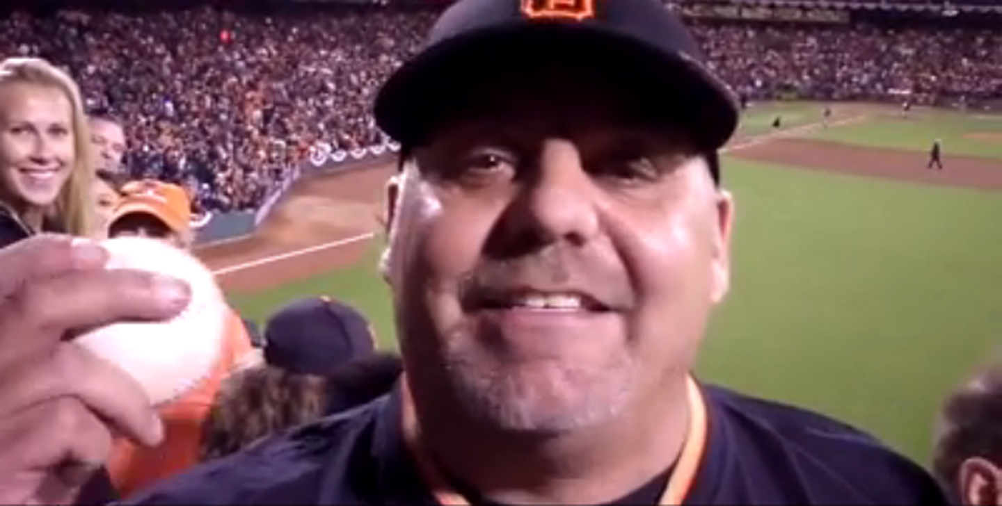 Frank Burke is the lucky fan who caught the game-winning ball that clinched the National League pennant, sending the San Francisco Giants to the 2014 World Series. (Ian Kay/MLB.com)