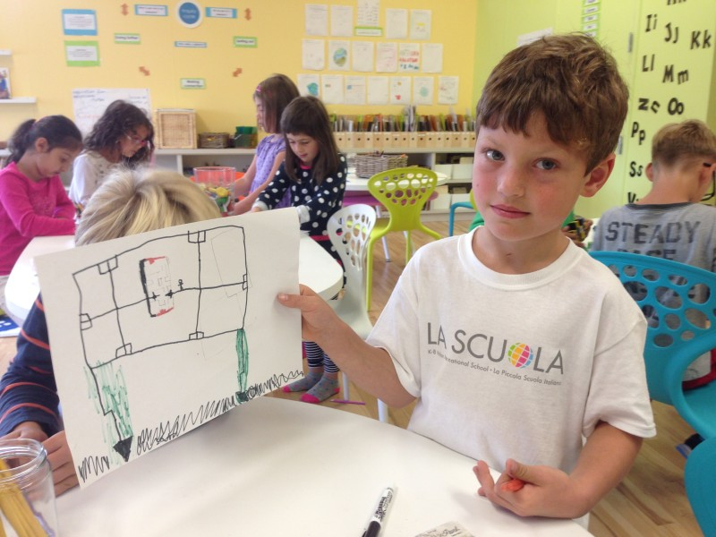 Aidan Mogal displays a drawing he made at La Scuola. Art is one of his favorite classes. (Patricia Yollin/KQED)