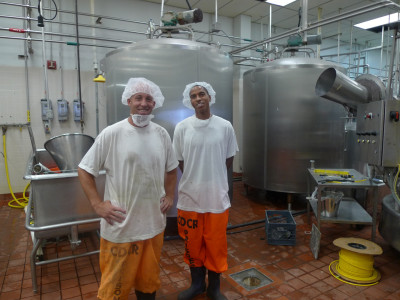 Inside the secure perimeter in the milk processing facility, Ryan Mons and Edward Wilson give a tour. (Lisa Morehouse/KQED)