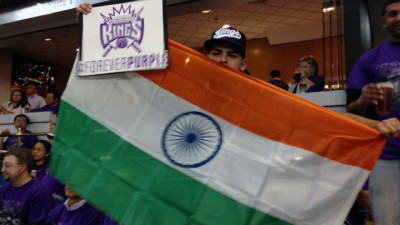Kings fan Ronnie Garcia holds an Indian flag at the Kings home opener on October 30, 2013. (Scott Detrow/KQED)