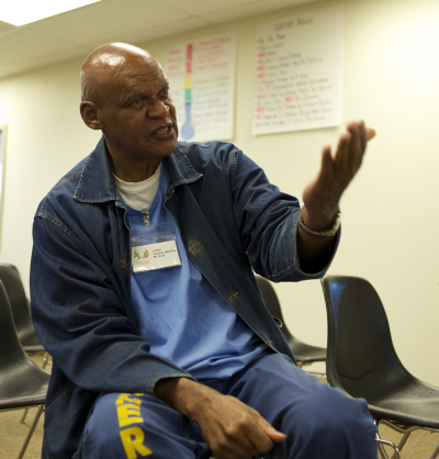 James Ward leads classes for other inmates hoping to get out. (Monica Lam/KQED)