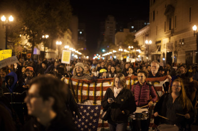 About an hour after the grand jury decision was announced, the protest ballooned in size, as demonstrators marched north on Broadway. (Mark Andrew Boyer/KQED)