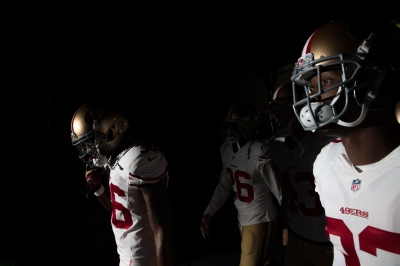 Members of the San Francisco 49ers before a game earlier this season in Denver. (Justin Edmonds/Getty Images)