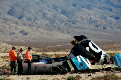 Kern County sheriff's deputies inspect part of the wreckage of Virgin Galactic's SpaceShipTwo, which crashed on a test flight over the Mojave Desert. (Sandy Huffaker/Getty Images)