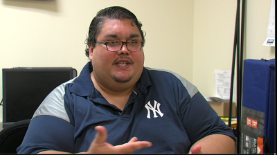 LaShawn Encarnacion has been battling morbid obesity and other health problems for years. He hopes the Patient Improvement Health Initiative will help him take better care of himself. (Nic McVicker/KPBS)