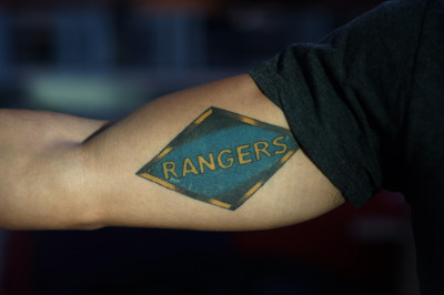 William Glazier shows off his tattoo that pays tribute to the 75th Ranger Regiment. (James Tensuan/KQED)