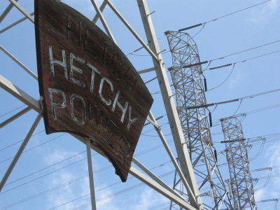 A weathered wooden sign in Fremont boasts electricity from Hetch Hetchy.
