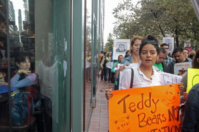 Protesters marched to the Immigration Court to speak out against the deportation of minors and families in September. (James Tensuan/KQED)
