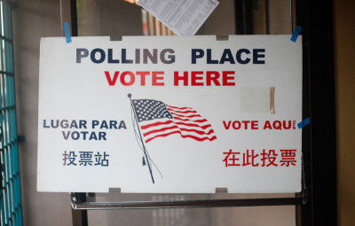 A sign welcomes voters to a polling place in the Mission. (Katie Brigham/KQED)