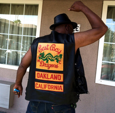 Melvin, 71, of the East Bay Dragons displays the group's patch in Fresno. (Aaron Mendelson/KQED)