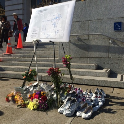 Advocates displayed 28 shoes for the people who've been killed in traffic collisions this year. (Photo: Bryan Goebel/KQED)