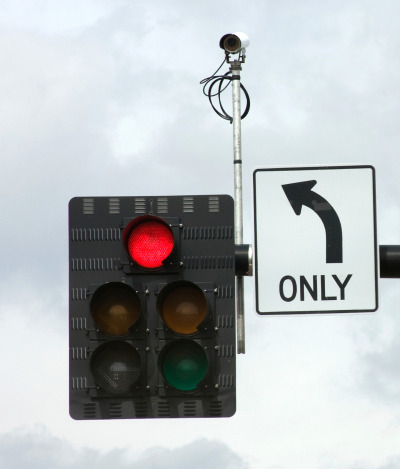 A surveillance camera mounted on a stoplight. (Getty Images)