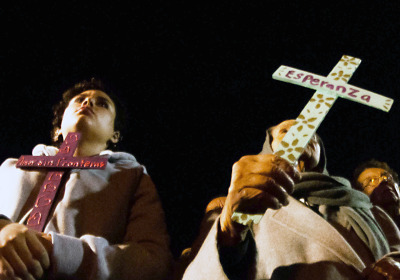 People say prayers at a vigil for the missing 43 students from Ayotzinapa at Our Lady of Guadalupe Church in Barrio Logan, San Diego. (Brooke Binkowski/KQED)