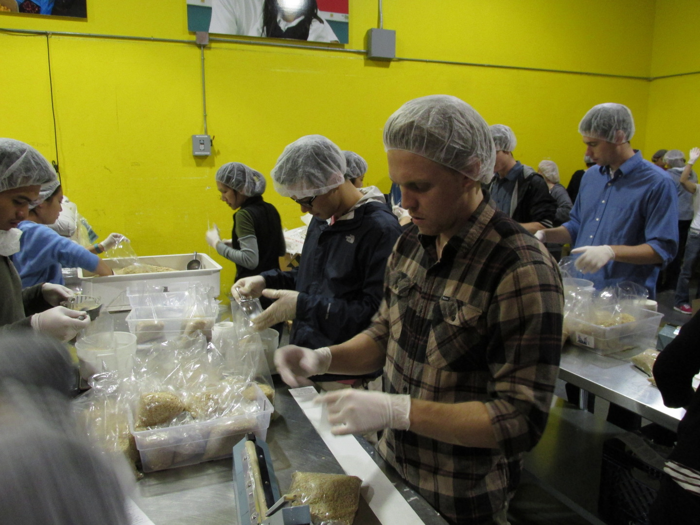 The San Francisco-Marin Food Bank saw about sixty volunteers show up to the warehouse the day before Thanksgiving. The organization's spokesperson, Blain Johnson, says they're expecting at least 90 volunteers to help out at the Potrero Hill warehouse on Turkey Day. (Sean McGrier/KQED)