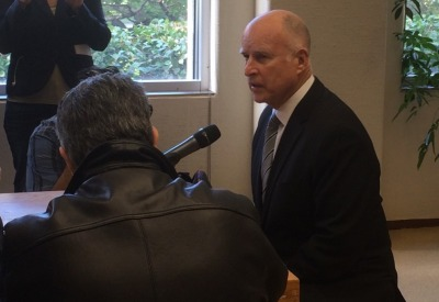 Gov.  Jerry Brown speaks to reporters in his Sacramento office. (Scott Detrow/KQED)