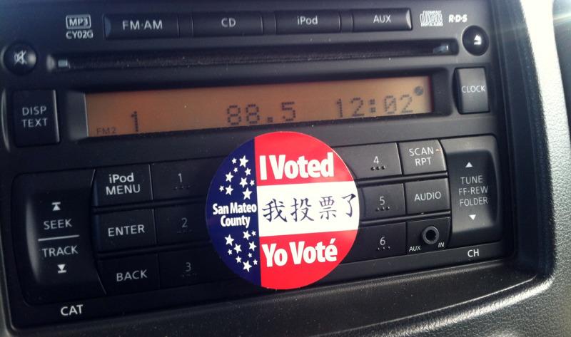 "KQED's Nina Thorsen proudly displays her ""I Voted"" sticker beneath her car radio, dutifully tuned to 88.5 FM. (Nina Thorsen/KQED)"