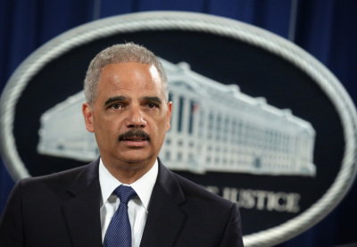 Attorney General Eric Holder sent a memo reversing the Justice Department's policy on transgender workers on Thursday. File photo.