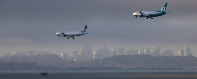 Planes flying into SFO.