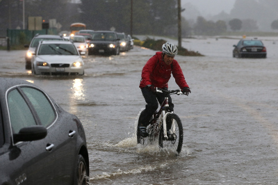 A cyclist in the Marin County town of Mill Valley during last week's big rains.  (Justin Sullivan/Getty Images)