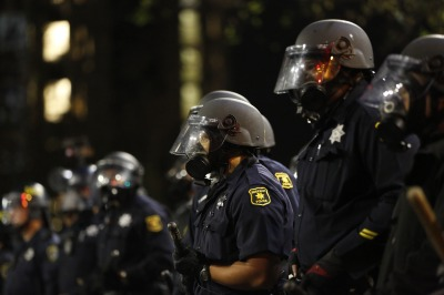 Berkeley officers advance on protesters during a protest against police violence on Saturday night. (Stephen Lam/Getty Images)