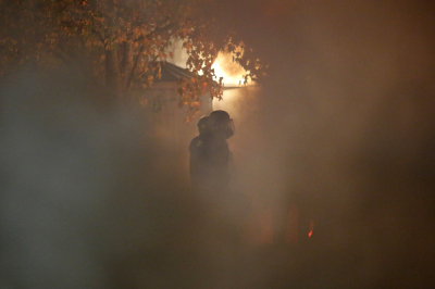 A police officer amid teargas and smoke during Sunday night's unrest in Berkeley.  (Stephen Lam/Getty Images)