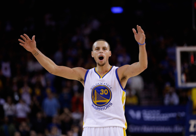 Stephen Curry tries to get the crowd louder during a game in December at ORACLE Arena.