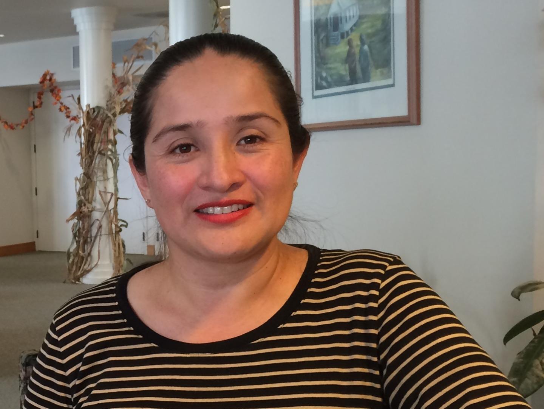 Airel Tinajero works at the Menlo Park Senior Center on Nov. 18, 2014. Tinajero, a Belle Haven resident, says she has noticed crime has plunged in her neighborhood.  (Farida Jhabvala Romero/Peninsula Press)