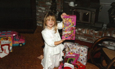 Amanda at six years old, celebrating Christmas with her new Barbie doll. (Avishay Artsy/KQED)
