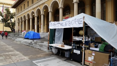 Activists trying to block sale of Berkeley's historic Main Post Office are outside the building on Thursday. (Lance Knobel/Berkeleyside)