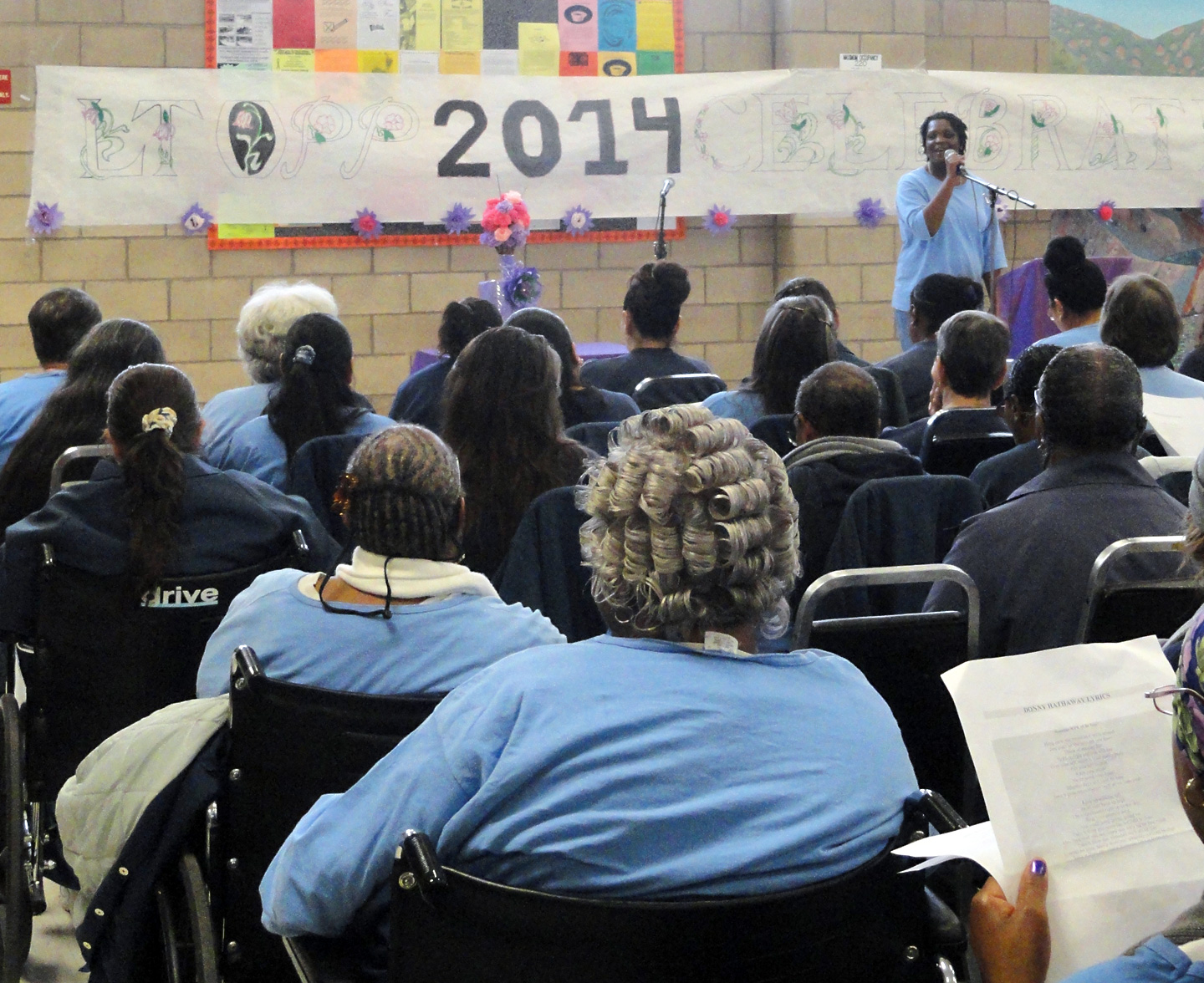 "About 150 women inmates attend a graduation ceremony for ""lifers"" who took a series of in-depth courses addressing substance abuse, anger management and understanding the impact of their crime on victims and others. Some of the women have spent most of their lives in prison and are now in wheelchairs or walkers."
