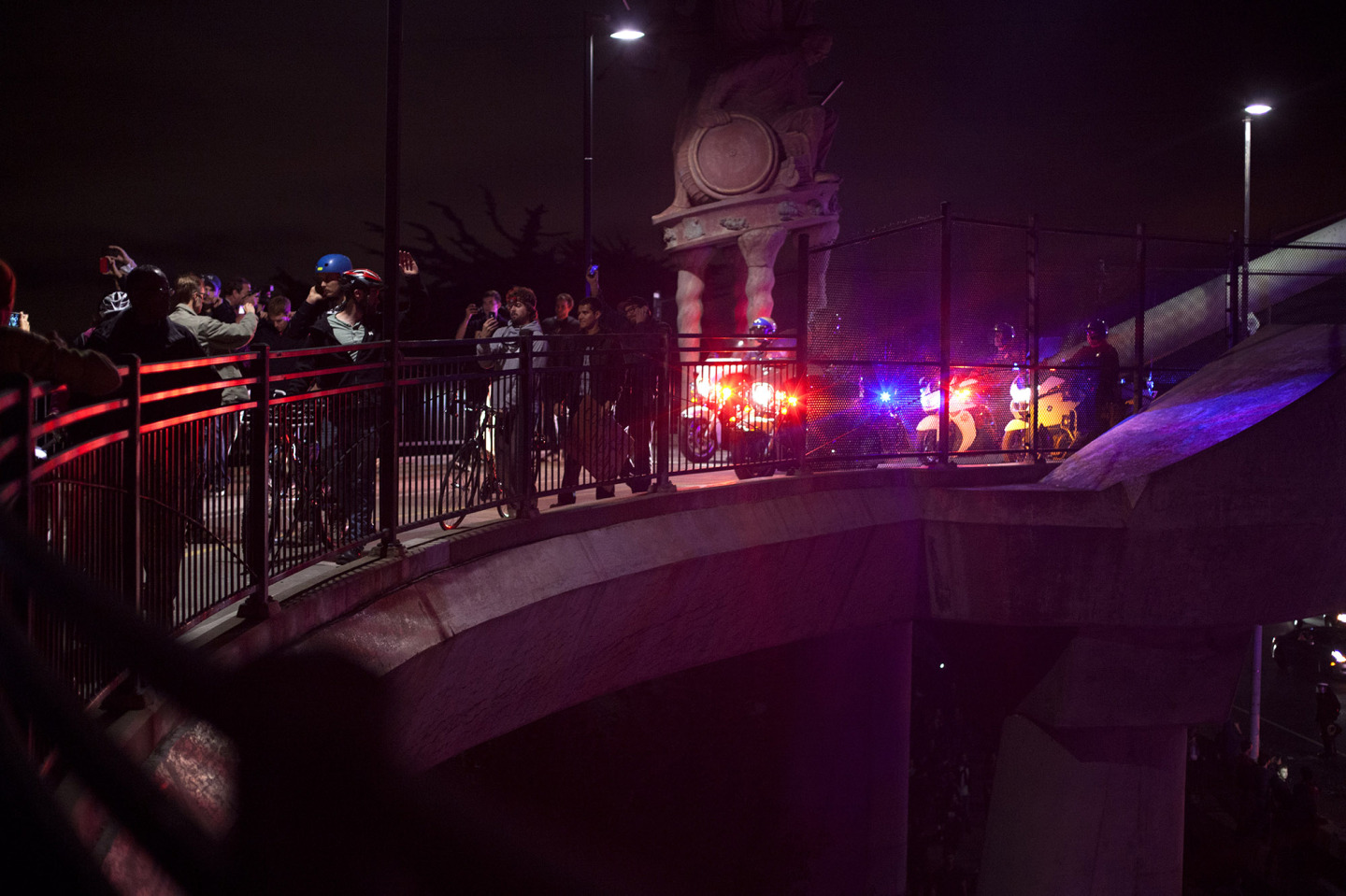 Stand off between protesters and police on I-80 pedestrian overpass. (Mark Andrew Boyer)