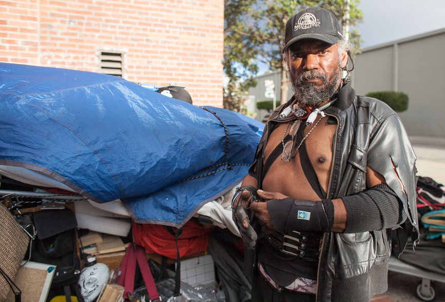 Kane, camping near Showplace Square at 15th and Utah streets, says police tell him to move from site to site. Sitting or lying on the sidewalk has been illegal in San Francisco since November 2010, when a majority of voters empowered police to fine, and sometimes arrest, people for the offense. (Eric Lawson / San Francisco Public Press)