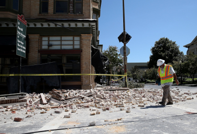 Dan Kavarian, chief building official with the City of Napa, surveys a building that was damaged by a 6.0 earthquake on August 24 in Napa, California.