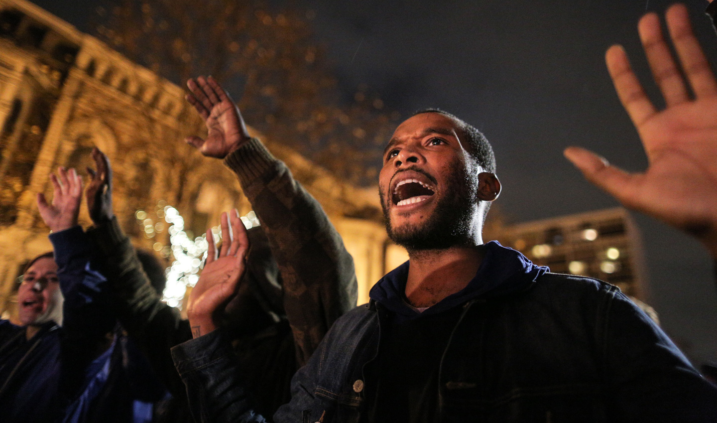 Protesters demonstrate following a New York grand jury's decision not to indict a police officer in the chokehold death of Eric Garner on December 3, 2014 in Oakland.