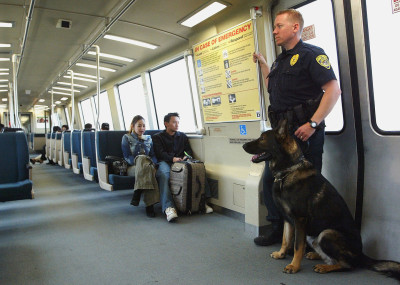 A BART police officer rides one of the system's trains. (Justin Sullivan/Getty Images)