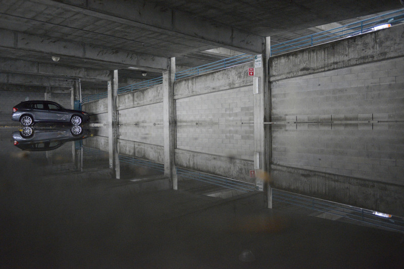 A lone car remains in a flooded parking garage off California Ave. in Palo Alto. (James Tensuan/KQED)