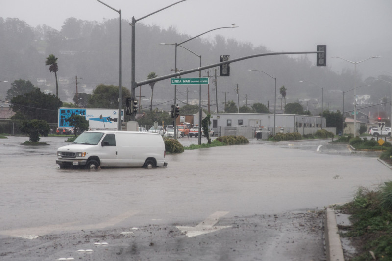 Flooded intersection in front of the Lindamar Shopping Center on Lindamar Boulevard in Pacifica, the morning of December 11. (Steve Byrne/KQED)