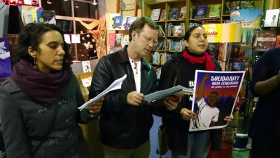 Protesters sing inside the Diesel bookstore on College Avenue in Oakland. (Andrew Stelzer/KQED)