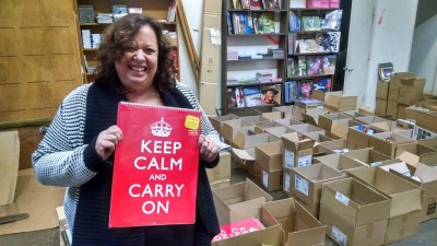 Pegasus Books owner Amy Thomas with just a few of the calendars on sale.