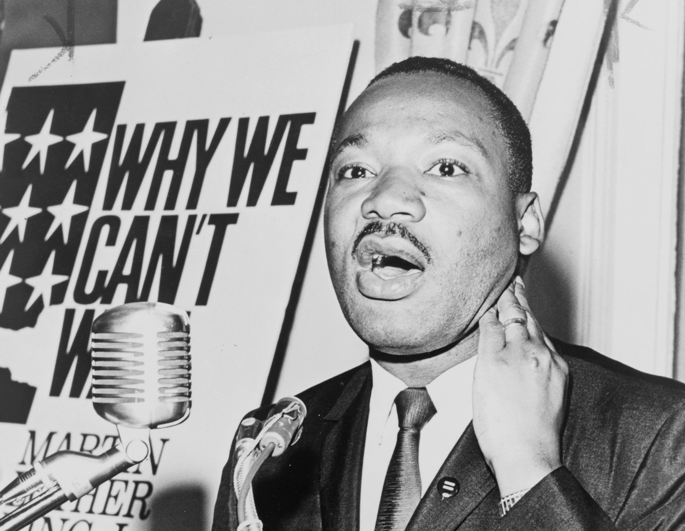 Martin Luther King, Jr., three-quarter length portrait, standing, facing front, at a press conference / World Telegram & Sun photo by Walter Albertin.