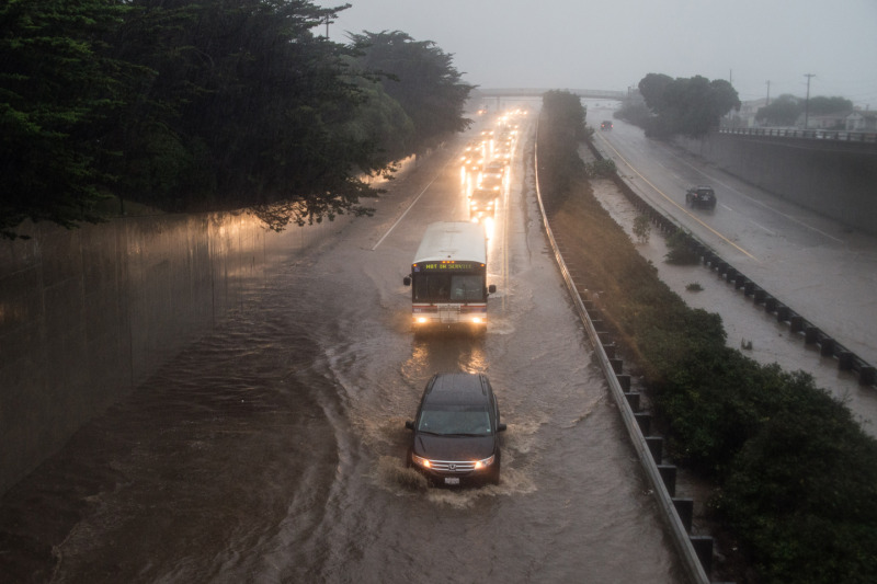 Flooding of Highway 1 at the Manor Drive overpass in Pacifica (Steve Byrne/KQED)