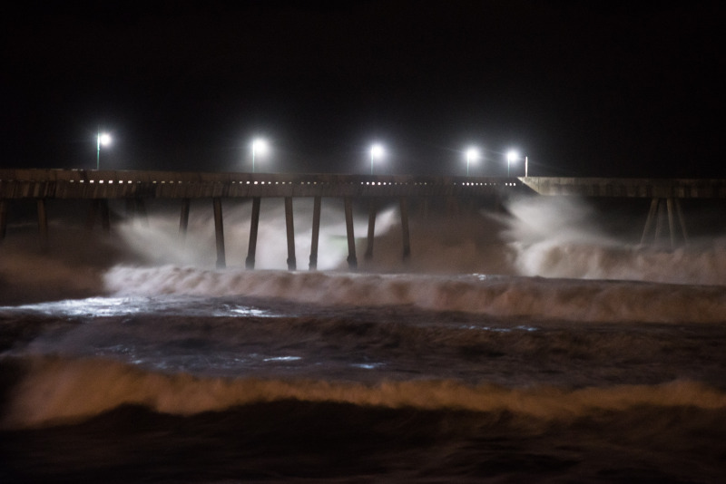 High surf rolls into the pier at Pacifica overnight. (Steven Byrne/KQED)
