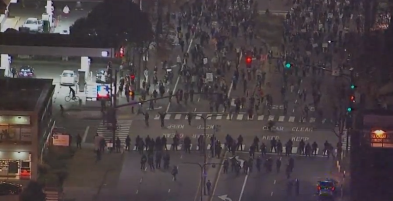 Police line at 6th St. and University Ave.