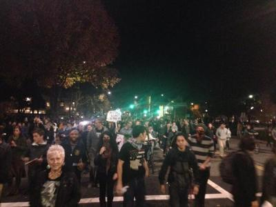 Protesters heading south on Martin Luther King Jr. Way. (Isabel Angell/KQED)