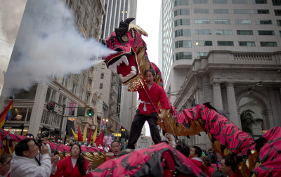 Members of the San Gabriel Valley Chinese Cultural Association prepare for the start of the Chinese New Year parade in downtown San Francisco. (Mark Andrew Boyer/KQED)