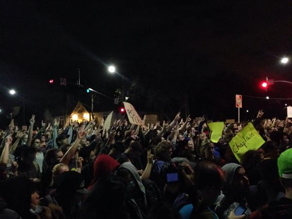 Crowd of protesters and police stand off at University and 6th in Berkeley. (Isabel Angell/KQED)