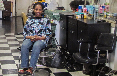 Bintou Diarra, a native of Mali, has seen her hair-braiding business decline since Ebola reached the United States this fall. (Andrew Stelzer/KQED)